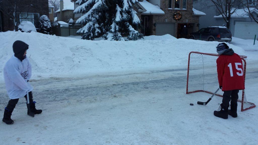 Street snow hockey in Canada.
